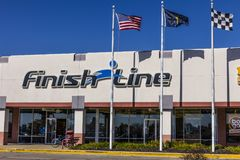 Indianapolis - Circa October 2017: Finish Line, Inc. Retail Strip Mall Location with the US, Indiana and Checkered Flags III. Finish Line, Inc. Retail Strip Mall Stock Photo
