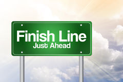 Finish Line, Just Ahead Green Road Sign Stock Images