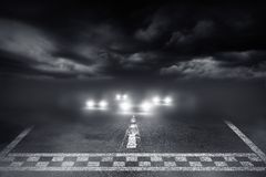 Finish line racing car driving. The fog road Stock Images