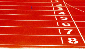 Finish line on running track. Running Track Finish. First to eighth place visible Royalty Free Stock Photos