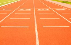 Finish line in tartan athletic track Royalty Free Stock Photo