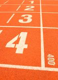 Finish line in tartan athletic track Royalty Free Stock Image