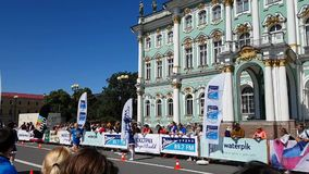 Finish line at the walls of the Hermitage building in St. Petersburg during the marathon. Spectators watch the race