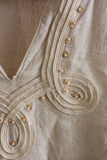 Finish linen tunics. Close-up of gauzy linen tunics finish Stock Photos