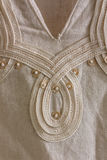 Finish linen tunics. Close-up of gauzy linen tunics finish Royalty Free Stock Images