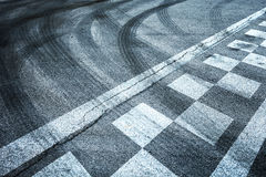 Finish pattern line with crossing of tires tracks Royalty Free Stock Photography