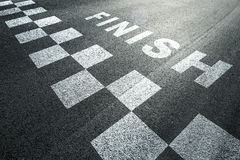 Finish race line on ashphalt road Royalty Free Stock Photography
