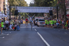 Finish!. Rider celebrates crossing the finish line of the 2015 Frederick Clustered Spires High Wheel Race, the only high wheel race of its kind in America stock photos