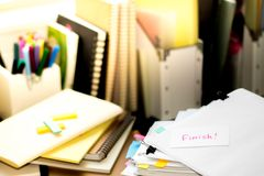 Finish; Stack of Documents. Working or Studying at messy desk. stock photography