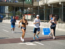 Finish of the Vancouver marathon. VANCOUVER - MAY 1: Gina Lawless Lahaina, Akira Nagae Tokorozawa, Saitama and Alan Lin approach the finish of the 2011 BMO 40th Royalty Free Stock Photography