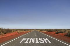 Finish written on the road. Finish written on white on the road, challenge message Royalty Free Stock Image
