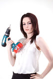 Finished. Young brunette posing with drill Royalty Free Stock Images