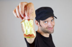Finished apple. A Man has just finished a Pear Stock Image