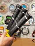 Finished base grips on 3 Tennis racquets Stock Photos