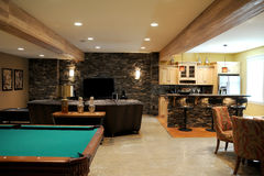 Finished basement. A cozy and beautifully decorated basement Royalty Free Stock Photography