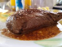 Finished beef steak. Is on a plate, steak with sauce on a plate stock photography
