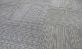 Finished carpet finish images with pattern and captured in very closeup in an office building muscat oman. Finished carpet floor in office royalty free stock photography