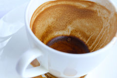 Finished coffee on a white plate. Closeup Stock Image