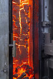 The finished coke into the open door of the coke oven Stock Images