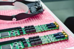 The finished electronic boards lie on a pink polyethylene substrate. Manufacture of electronic circuit boards and components Stock Images