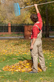 Finished garden raking. A happy man after having finished raking up his garden royalty free stock images