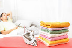 Finished with ironing and watching tv Stock Photos