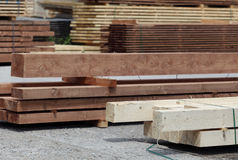 Finished lumber in lumberyard. Stacks of various size and shape of finished wood or lumber neatly sorted by products in a lumber yard Stock Images
