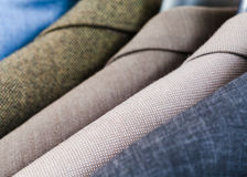 Finished male coats in tailoring atelier Royalty Free Stock Images
