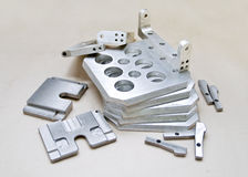 Finished mold pieces. Finished aluminum mold pieces on paper Royalty Free Stock Photo