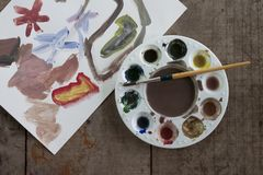 Finished paintings on wooden boards have a palette and a puddle placed on top. royalty free stock photos
