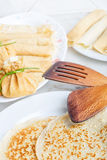 Finished pancakes cheese fritters on plates for breakfast. Royalty Free Stock Image