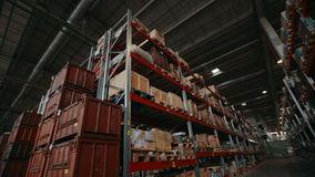 Finished products in boxes and containers on logistic warehouse shelves at plant