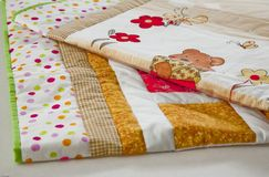 Finished quilt with tiny bear. Patchwork quilt decorated with tiny bear Royalty Free Stock Photo