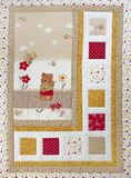 Finished quilt with tiny bear. Patchwork quilt decorated with tiny bear Royalty Free Stock Images