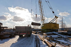 The finished shell of the heat exchanger unload the crane. On the basis of equipment Royalty Free Stock Photo
