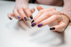 Finished shellac manicure girl in beauty salon Stock Photo