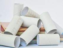 Finished Toilet paper rolls isolated on over white. Environmental protection concept. waste management concept. royalty free stock photo