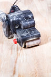 Finishing ashwood furniture board by belt sander Stock Image