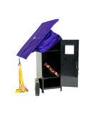 Finishing business classes. Black metal locker, graduation mortar board with tassle, leather briefcase used to carry items to the office Stock Images