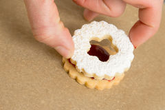 Finishing decorated cookie Royalty Free Stock Images