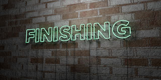 FINISHING - Glowing Neon Sign on stonework wall - 3D rendered royalty free stock illustration Royalty Free Stock Image