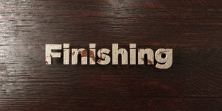 Finishing - grungy wooden headline on Maple  - 3D rendered royalty free stock image. This image can be used for an online website banner ad or a print postcard Royalty Free Stock Image