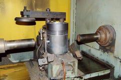 Finishing hole of the piston. Image finishing holes of the piston on the CNC machine Stock Photos