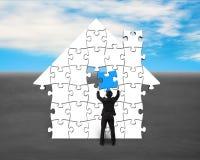 Finishing house shape puzzles assembling Stock Photos