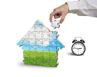 Finishing house shape puzzles assembling Royalty Free Stock Photos
