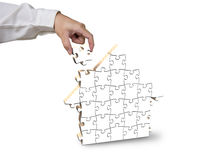 Finishing house shape puzzles Royalty Free Stock Image