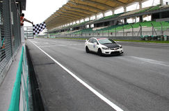 Finishing line. Anonymous racer pass the checker flag in Sepang International Circuit during HPC event on May 2010, Malaysia Stock Photos