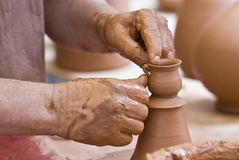 Finishing a little pot. Stock Photos