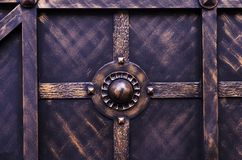 Finishing metal doors with modern forged elements.  stock image