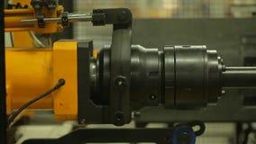 Finishing metal working on lathe grinder machine. Metalworking industry: finishing metal working on lathe grinder machine stock footage